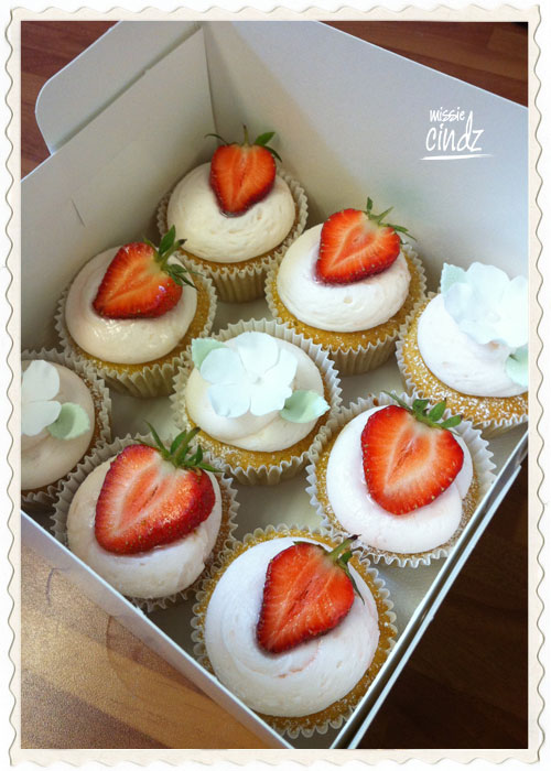 White chocolate & vanilla cupcakes with homemade strawberry compote.