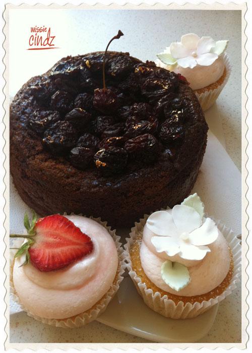 Rich Valrhona chocolate mud cake and chilli cherries with cupcakes