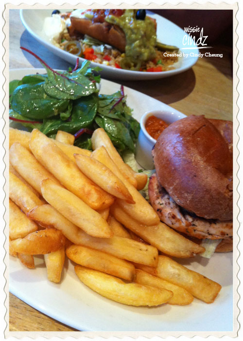 Red Peppers spicy Thai chicken burger served with peanut sauce and fries