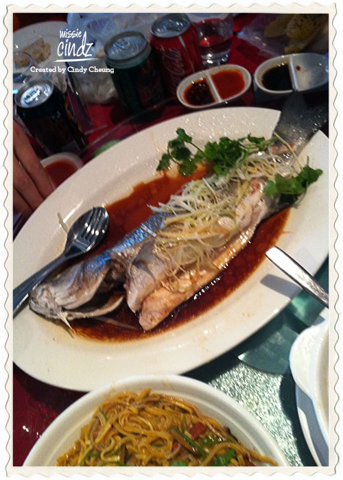 Whole steamed fish served with fresh ginger and spring onions