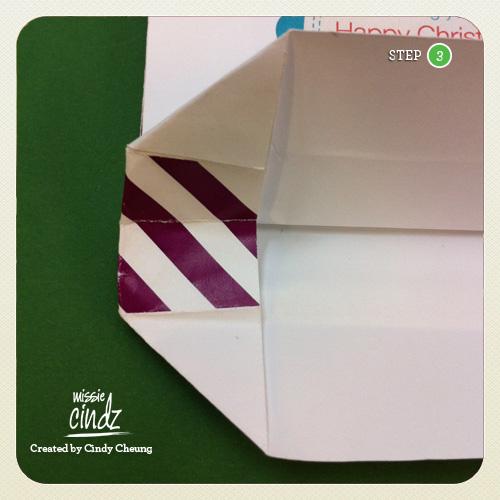 Steps 3: fold back the scored line at the bottom. Open out the bottom, push out fold and fold down.