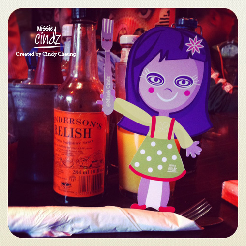 Missie Cindz with her bottle of Hendersons Relish - The Spicy Yorkshire Sauce
