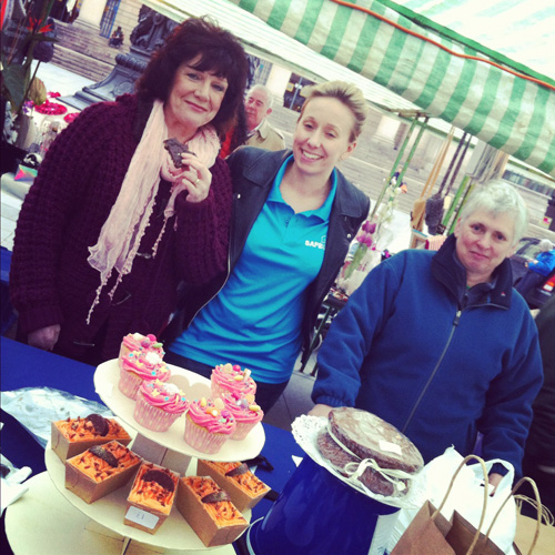 Volunteers from Safe At Last. Delicious cakes for sale, raising funds for young runaways.