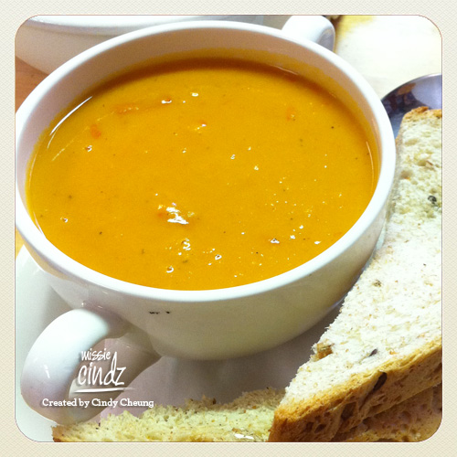 Enjoying a bowlful of homemade spicy butternut squash soup from Harland Cafe.